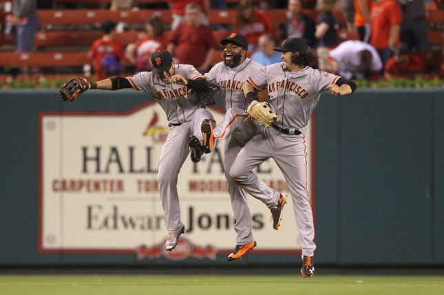 San Francisco Giants outfielders (L to R) Gregor Blanco, Denard Span and Jarrett Parker celebrate their 5-1 win over the St. Louis Cardinals at Busch Stadium in St. Louis on June 3, 2016. File photo by Bill Greenblatt/UPI