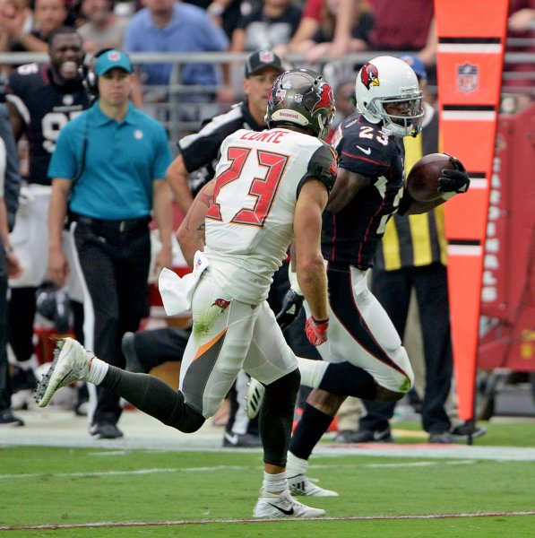 Arizona Cardinals running back Adrian Peterson runs for a first down against the Tampa Bay Buccaneers during their game earlier in the week. Photo by Art Foxall/UPI