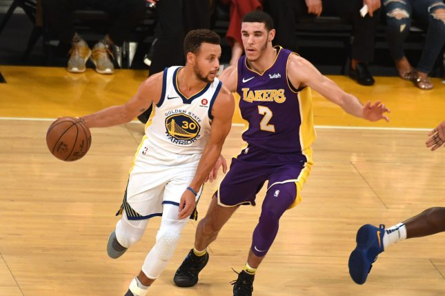 Golden State Warriors guard Stephen Curry drives by Los Angeles Lakers guard Lonzo Ball (R) on November 29, 2017 at Staples Center in Los Angeles. File photo by Jon SooHoo/UPI