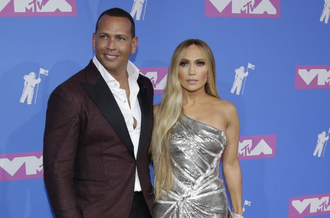 Jennifer Lopez (R), pictured with Alex Rodriguez, confirmed she's very happy with the retired MLB star. File Photo by Serena Xu-Ning/UPI