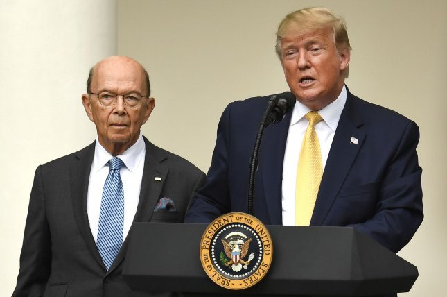 President Donald Trump (R) makes remarks on immigration as Commerce Secretary Wilbur Ross listens in the Rose Garden of the White House on Thursday. Photo by Mike Theiler/UPI