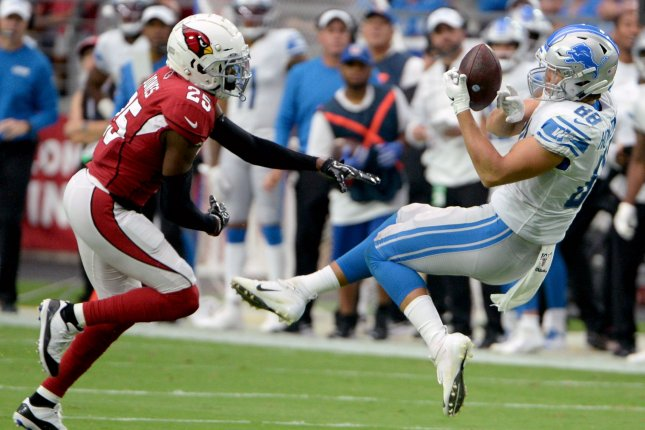 Detroit Lions rookie tight end T.J. Hockenson (R) suffered a right ankle injury during Thursday's game against the Chicago Bears. File Photo by Art Foxall/UPI