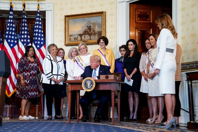 President Donald Trump and first lady Melania participate Tuesday in an event honoring the 100th Anniversary of the ratification of the 19th Amendment to the Constitution, in the Blue Room of the White House. Photo by Anna Moneymaker/UPI/Pool