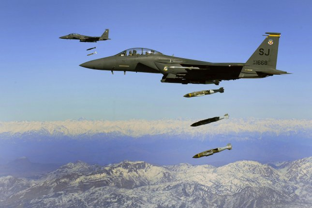 U.S. Air Force F-15E Strike Eagles, from the 335th Expeditionary Fighter Squadron, drops 2,000 pound Joint Direct Attack Munitions on a cave in eastern Afghanistan on November 26, 2009. The 335th is deployed to Bagram Airfield, Afghanistan, from Seymour Johnson Air Force Base, North Carolina UPI/Michael B. Keller/U.S. Air Force