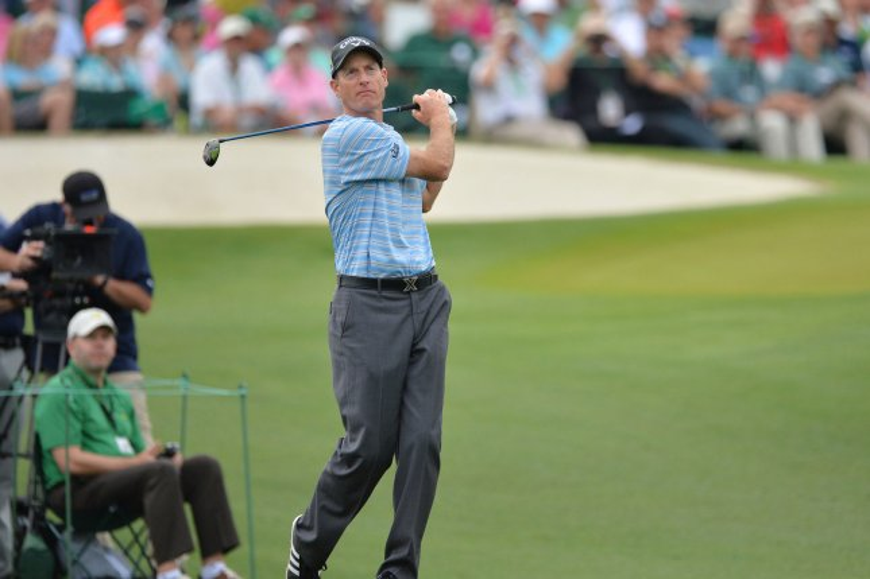 Jim Furyk hits his tee shot. Photo by Kevin Dietsch/UPI