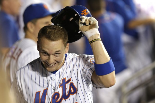 New York Mets' Brandon Nimmo celebrates with teammates after he scores a run in the 7th inning against the Chicago Cubs at Citi Field in New York City on June 30, 2016. Photo by John Angelillo/UPI