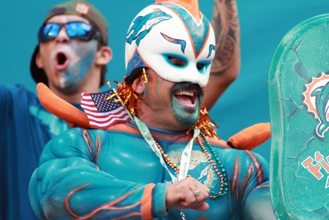 Miami Dolphins fans celebrate a touchdown at Hard Rock Stadium in Miami, Florida. File photo by Susan Knowles/UPI