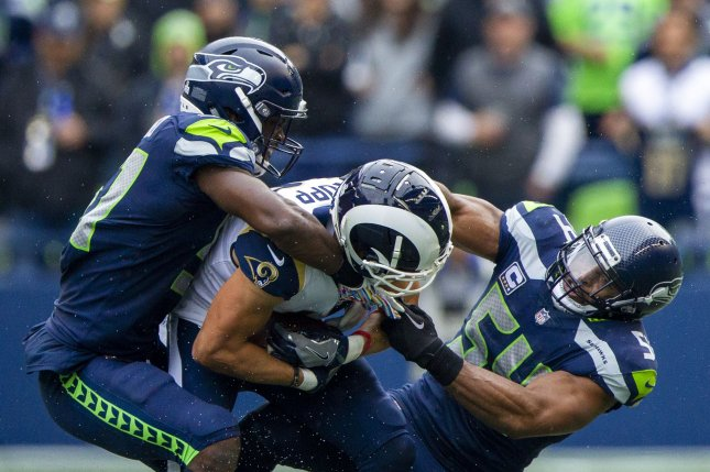 Seattle Seahawks linebackers Barkevious Mingo (51) and Bobby Wagner (54) team up to tackle Los Angeles Rams wide receiver Cooper Kupp (18) during the fourth quarter on Sunday at CenturyLink Field in Seattle, Washington. Photo by Jim Bryant/UPI