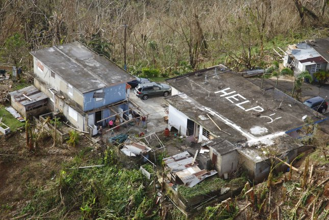 A call for help is placed on the roof of a home in Puerto Rico following Hurricane Maria in 2017.Wednesday's report says natural disasters caused three times more displacements than conflict and violence in 2020. File Photo by Kris Grogan/U.S. Customs and Border Protection/UPI