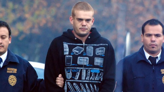 Dutch murder suspect Joran van der Sloot is escorted by Chilean police to an awaiting plane in Santiago, Chile, on June 4, 2010. He was to be flown to northern Chile and then transferred overland to Peruvian authorities. He was convicted of killing 21-year-old Stephany Flores in a Lima, Peru hotel room. Van der Sloot, a citizen of the Netherlands, remains the prime suspect in the disappearance of Natalie Holloway, an Alabama teenager, on the island of Aruba in 2005. UPI/Dinko Eichin