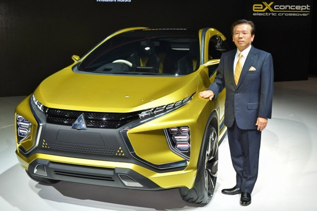 Mitsubishi Motors President Tetsuro Aikawa poses with eX Concept during the news conference at the 44th Tokyo Motor Show 2015. On Wednesday, Aikawa admitted Mitsubishi falsified fuel economy data for its ultrasmall cars since 2013. File Photo by Keizo Mori/UPI