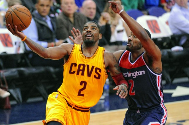 f741fb431ce0 Cleveland Cavaliers guard Kyrie Irving (2) scores against Washington  Wizards guard John Wall (2) in the first half at the Verizon Center in  Washington