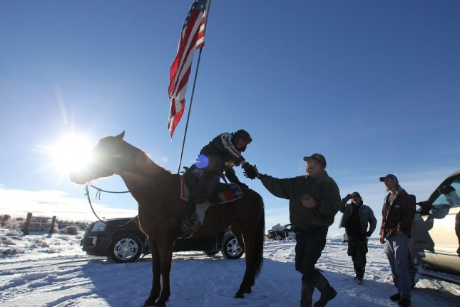 Duane Ehmer, of Irrigon, Ore., (left) greets activist Brad Williams at the Malheur National Wildlife Reserve on January 15, 2016, in Burns, Ore. The group's leader, Ammon Bundy, and six others went on trial Tuesday on federal conspiracy charges over the standoff, which lasted for 41 days. File Photo by Jim Bryant/UPI
