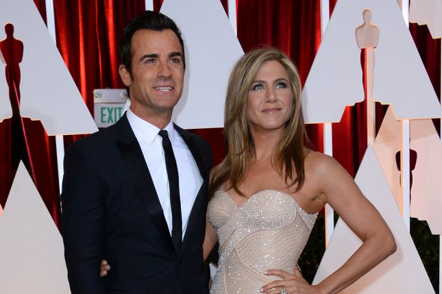 Justin Theroux (L) and Jennifer Aniston at the Academy Awards on February 22, 2015. The couple married in August 2015. File Photo by Jim Ruymen/UPI