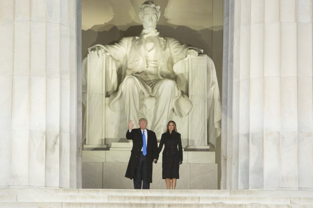 President-elect Donald J. Trump and wife Melania appear at the Make America Great Again celebration concert at the Abraham Lincoln Memorial in Washington, D.C., on Thursday. The day's celebrations formally started Trump's inauguration as 45th president of the United States -- and ended with the billionaire pledging to make the government work for everybody. Photo by Chris Kleponis/UPI/Pool