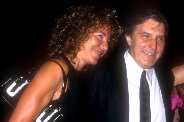 Emanuel Ungaro (C) died Sunday at the age of 86, leaving behind his wife, Laura Bernabei (L), and a daughter. Here he is pictured in Sept. 5, 2001, at a party celebrating the 35th Anniversary of Ungaro Fashions at the Armory in New York City. Photo by Laura Cavanaugh/UPI