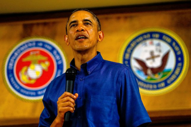 U.S. President Barack Obama makes his annual trip to greet current and retired members of the U.S. military and their families as they eat a Christmas Day meal in the Anderson Hall mess hall at Marine Corps Base Hawaii at Kaneohe Bay in Kaneohe Bay, Hawaii on December 25, 2013. UPI/Kent Nishimura/Pool