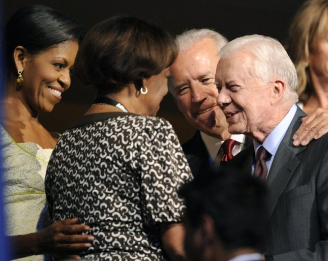 Former President Jommy Carter (2nd-R) talks to Michelle Obama's mother Marian Robinson while Sen. Joe Biden (D-DE), Barack Obama's vice president pick, watches on during the second night of the Democratic National Convention in the Pepsi Center in Denver on August 26, 2008. (UPI Photo/Kevin Dietsch)