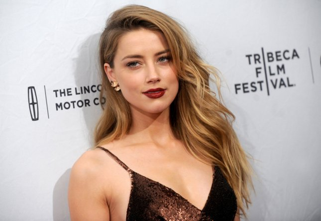 Amber Heard dated actor Johnny Depp for a bout 2 years before their marriage, which occurred in February 2015. Photo by Dennis Van Tine/UPI