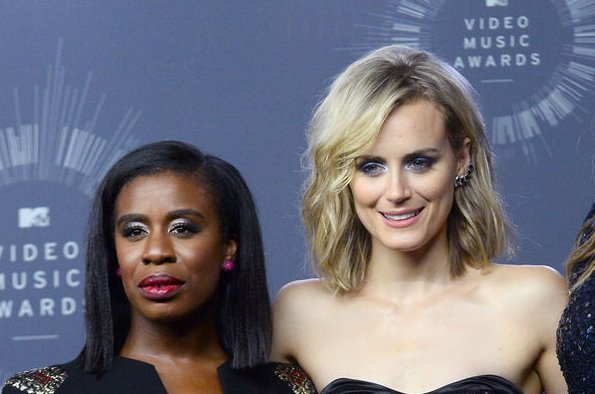 Taylor Schilling (R) and 'Orange is the New Black' co-star Uzo Aduba at the 2014 MTV Video Music Awards in Aug. 2014. The actresses are friends on and off-set of the Netflix series. File photo by Jim Ruymen/UPI