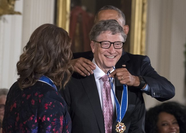 Bill Gates, shown here recieving the Presidential Medal of Freedom on November 22, announced the involvement of his foundation in a $460 million initiative to prepare vaccines which could reduce the global impact of epidemics. The announcwement of the Coalition for Epidemic Preparedness Initiative was made in Davos, Switzerland. File Photo by Pat Benic/UPI