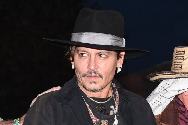 Johnny Depp attends the Glastonbury Music Festival in Somerset, England on June 22. Depp was featured in the new poster for Murder on the Orient Express this week. File Photo by Rune Hellestad/UPI
