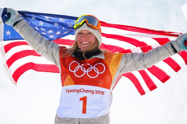 Jamie Anderson of Team USA poses with an American flag after winning gold in the ladies' snowboard slopestyle finals on day three of the 2018 Pyeongchang Winter Olympics on February 12 in Pyeongchang, South Korea. File Photo by Matthew Healey/UPI