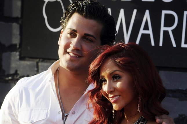 Nicole Snooki Polizzi (R), pictured with Jionni LaValle, is expecting another son with her husband. File Photo by Dennis Van Tine/UPI