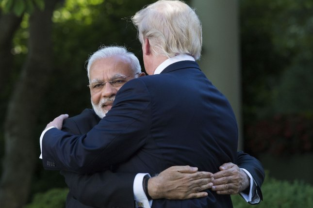 Indian Prime Minister Narendra Modi embraces U.S. President Donald Trump in 2017 during a visit to the White House. File Photo by Kevin Dietsch/UPI