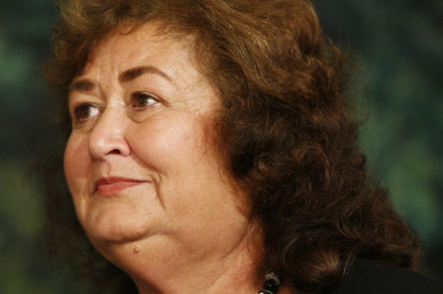 Jeanne White-Ginder, the mother of Ryan White, shown at the White House in 2009, said Wednesday it is still therapeutic for her to talk about her son 30 years after his death. Photo by Aude Guerrucci/UPI