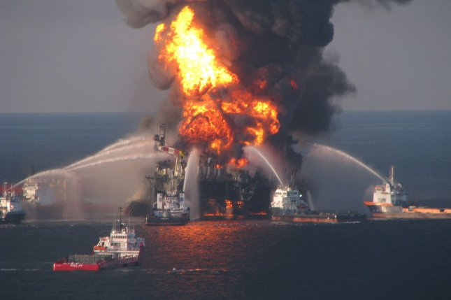 Fire boat response crews battle the blazing remnants of off shore oil rig Deepwater Horizon off the coast of New Orleans on April 21, 2010. File Photo courtesy of U.S. Coast Guard