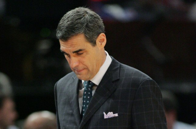 Villanova also paused team activities last week after head coach Jay Wright (pictured) and a staff member tested positive for COVID-19. File Photo by Monika Graff/UPI
