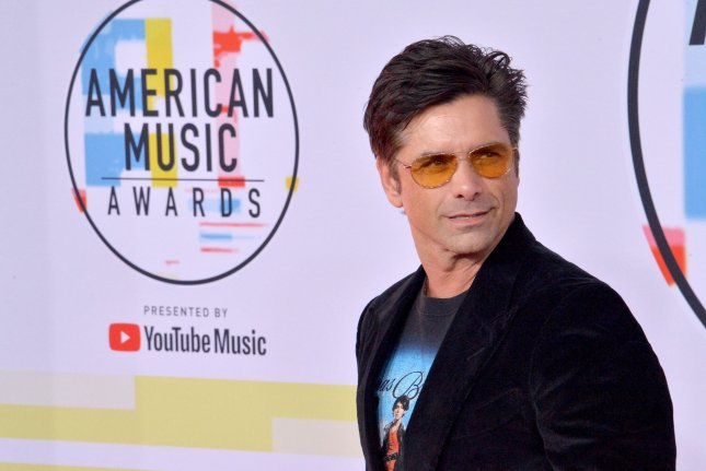 John Stamos is recovering from minor surgery on his hand. File Photo by Jim Ruymen/UPI