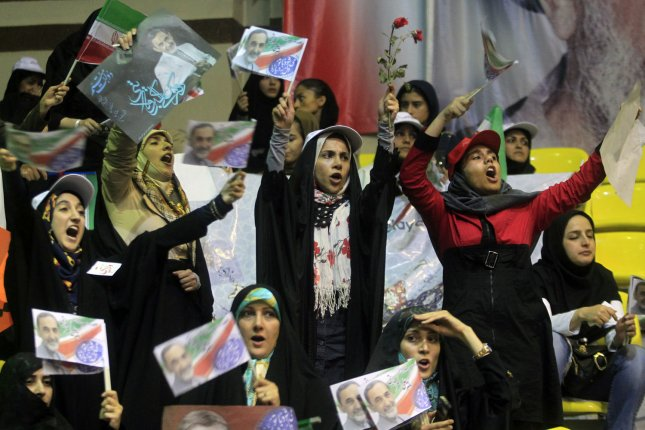 Supporters of presidential candidate Ali Akbar Velayati hold his posters during a presidential campaign rally in Tehran, Iran on June 12, 2013. Iran's presidential election will be held on June 14. UPI/Maryam Rahmanian