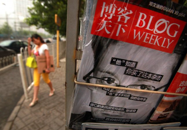 A popular Chinese magazine featuring a front-page story on American Edward Snowden is sold at a news stand in Beijing on June 25, 2013. UPI/Stephen Shaver