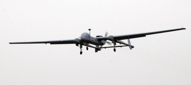 An Israeli made unmanned aerial vehicle, the Heron TP, flies during it's induction ceremony into the Israeli Air Force at the Tel Nof Air Force Base, February 21, 2010. The large drone is built by the Israel Aerospace Industries, IAI, and is capable of flying to Iran. It has a wingspan of 86 feet, the size of a passenger jet and can fly 20 consecutive hours. The drone is primarily used for surveillance and carrying payloads. UPI/Debbie Hill