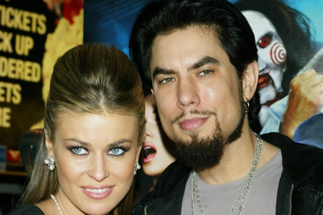 Carmen Electra and husband Dave Navarro arrive for the premiere of her new movie Scary Movie 4 at the Loews Lincoln Square Theater in New York on April 10, 2006. (UPI Photo/Laura Cavanaugh)