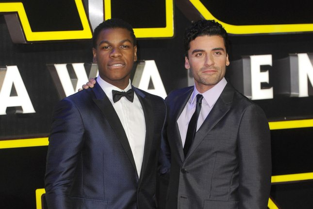 """Cast members John Boyega and Oscar Isaac attend the European Premiere of """"Star Wars: The Force Awakens"""" in London on December 16. The film has become the highest-grossing movie at the U.S. box office history. Photo by Paul Treadway/ UPI"""