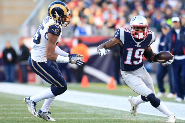 New England Patriots wide receiver Malcolm Mitchell (19) stays in-bounds while avoiding a tackle by Los Angeles Rams cornerback Michael Jordan (35) on an 11-yard reception in the third quarter at Gillette Stadium in Foxborough, Massachusetts on December 4, 2016. The Patriots defeated the Rams 26-10 and Brady became the NFL's all-time leader for wins by a quarterback for a total of 201 wins in 264 games. Photo by Matthew Healey/ UPI