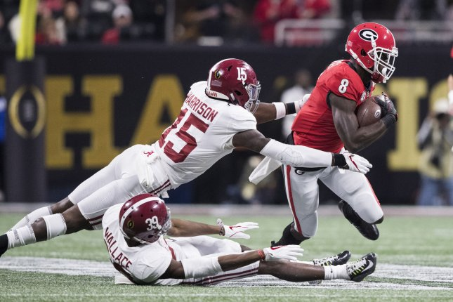 Georgia Bulldogs wide receiver Riley Ridley (8) gets past Alabama Crimson Tide defensive back Ronnie Harrison (15) and Alabama Crimson Tide defensive back Levi Wallace (39) in the first half of the NCAA College Football Playoff National Championship Game on January 8, 2018 at Mercedes-Benz Stadium in Atlanta. Photo by Mark Wallheiser/UPI