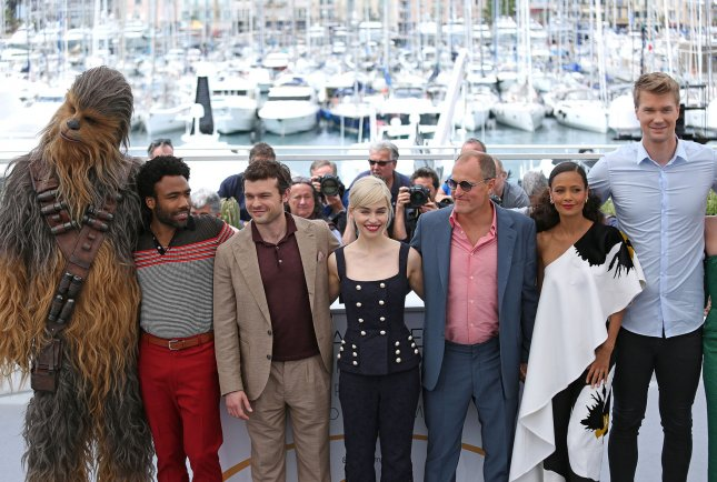 Chewbacca, Donald Glover, Alden Ehrenreich, Emilia Clarke, Woody Harrelson, Thandie Newton and Joonas Suotamo arrive at a photocall for the film Solo: A Star Wars Story in Cannes, France on May 15. File Photo by David Silpa/UPI