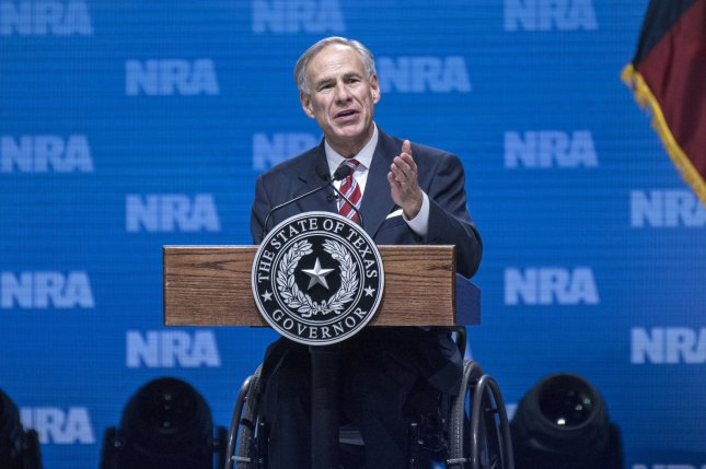 Texas Gov. Greg Abbott said the state and non-profit organizations should concentrate resources on those already here. File Photo by Sergio Flores/UPI