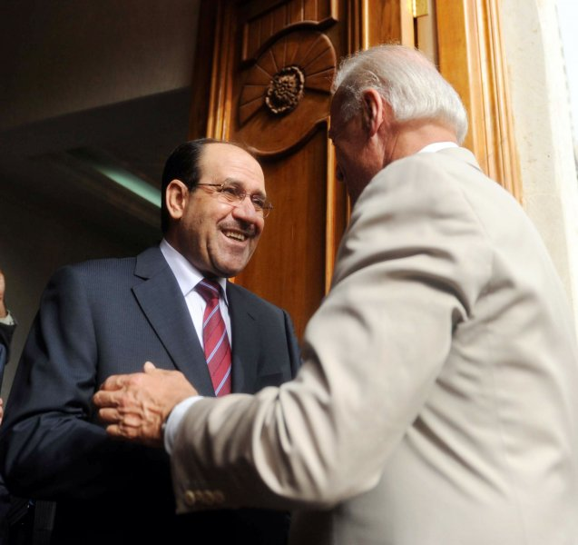 U.S. Vice President Joe Biden (R) shakes hands with Iraq's Prime Minister Nuri al-Maliki in Baghdad on July 4, 2010. UPI