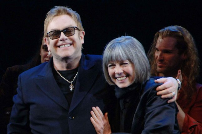 Composer Sir Elton John and author Anne Rice join the Broadway cast of Lestat for their April 25, 2006 opening night curtain call bows at New York's Palace theater. Rice's Vampire Chronicles novels are being adapted as a television series. File Photo by Ezio Petersen/UPI