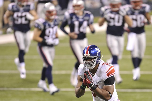 New York Giants defensive end Justin Tuck gestures after stopping a New England Patriots drive in the third quarter during Super Bowl XLVI at Lucas Oil Stadium in Indianapolis. File photo by Brian Kersey/UPI
