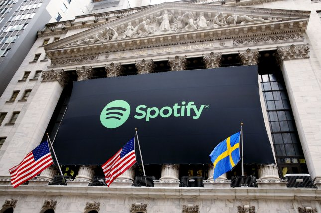 A banner advertising Spotify's public trading debut hangs from the facade of the NYSE on Tuesday in New York City. The online-music streaming service starts trading at the exchange with the hopes of surpassing other music services such as Apple Music and Pandora. Photo by Monika Graff/UPI