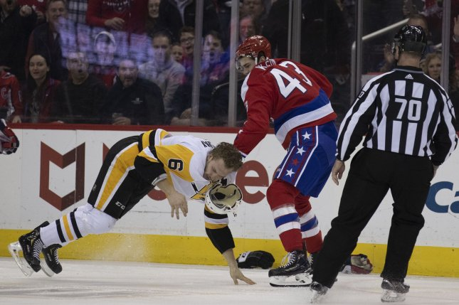 Washington Capitals right wing Tom Wilson (43) fights Pittsburgh Penguins defenseman Jamie Oleksiak (6) during the first period on Wednesday at Capital One Arena in Washington, D.C. Photo by Alex Edelman/UPI