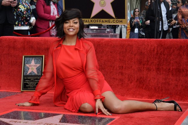 Taraji P. Henson sits beside her star during an unveiling ceremony honoring her with the 2,655th star on the Hollywood Walk of Fame in Los Angeles on Monday. Photo by Jim Ruymen/UPI.