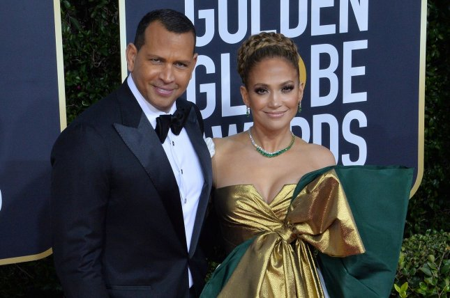 Alex Rodriguez (L) and Jennifer Lopez attend the 77th annual Golden Globe Awards on Sunday. Photo by Jim Ruymen/UPI