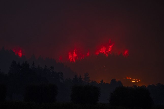 Flames move alonng a ridge line in the Glass Fire in Napa County, Calif., on Sunday. Photo by Terry Schmitt/UPI